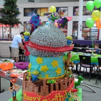 Toy Story Tiered Cake This cake had 3 tiers. Each tier represented a different character. I purchased the figurines on the cake. The ring on the top is poured...