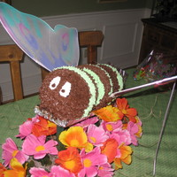 Butterfly Cake This was one of my first big cakes. I used a ball pan to make the body. The wings were from a Halloween costume. I anchored them to the...