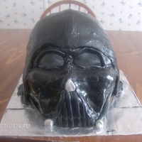 Darth Vader this was a chocolate cake with chocolate buttercream icing. covered in MMF