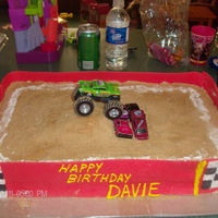 "Monster Jam Birthday The cake was 2 8x13"" confetti cakes, covered in vanilla BC. the ""dirt"" was made from graham crackers. chalk line was made of..."