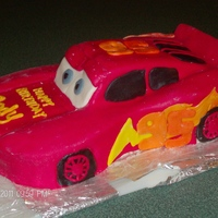 "Lightning Mcqueen This was originally an 8x13"" cake that i cut and shaped into the car body. the car was then iced in a vanilla BC. The spoiler was made..."