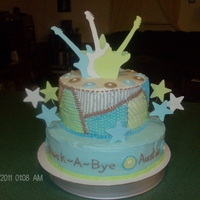 Rock-N-Roll Baby Shower bottom tier was yellow cake, top tier was chocolate. covered in vanilla BC, all details were piped on. stars and guitars were made from...