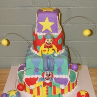 4 Tiered Circus Cake This is a 4 tiered cake, 12' round, 8' square, 6' round, 4' square. All decorations are made out of MMF, including the...