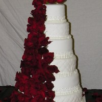 Cascade Of Roses This is a 6 tiered round cake, 6, 8, 10, 12, 14, and 16in cakes. They are made with MMF. and fresh roses. Fun to make!