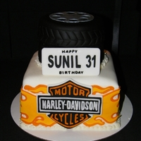 Harley Cake The cakes are covered with MMF. All decorations are made out of wilton of Satin Ice fondant,and cut with a Cricut Cake, using Make the Cut...