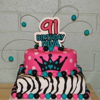Birthday Diva This is a 10 inch round on top of a 12 inch square. The cake is covered in MMF, so are the balls. All other decorations are made from...
