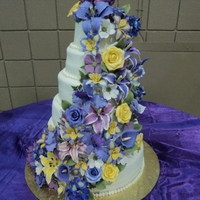 Quinceanera Floral Cake Six-tier fondant cake with gumpaste flowers.
