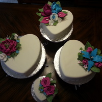 Heart Shaped Cakes With Fondant And Gumpaste Flowers Heart-shaped cakes with fondant and gumpaste flowers.
