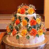 Bright And Colourfull A three tier cake all covered in fondant with gumpaste roses . the babies breath is real
