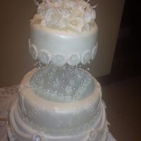 Wedding Cake With Flowers And Pearls This is a wedding cake for a friends daughter three tiers with flowers and pearls