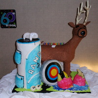 Deer, Golf And Fishing Cake This is all edible, there is a deer, a golf bag, a target and a salmon! It was alot of work but was worth it!