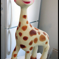 Sophie The Giraffe i now see that i made her eyes WAY to big, but shes still cute. White chocolate ganached, legs and head are cereal treats, neckand body are...