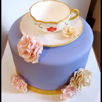 Tea Party Cake Gumpaste teacup and dish, gumpaste carnations. White almond sour cream with lemon curd filling. it was a lovely light violet color, the...