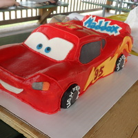 Lightening Mcqueen Cake Lightening McQueen cake covered in red buttercream with details done in modeling chocolate.