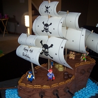 Pirate Ship Cake Made from Vanilla cake filled with chocolate mousse and covered in chocolate buttercream.