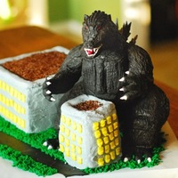 Godzilla Cake Building is actually the cake. Godzilla is made of RKT covered in equal parts fondant and modeling chocolate mixed together. Birthday boy...