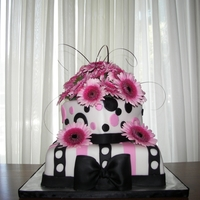 Black And Pink Wedding Cake The flowers are real and the top tier is vanilla with a raspberry filling , and the bottom tier is a chocolate cake with a chocolate...