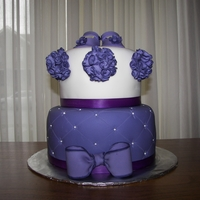 Purple Baby Shower Cake Vanilla cake with a raspberry filling. the ribbon around the tiers is a really ribbon.