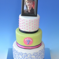 A Crush On The Biebs three tiers, 4 layers each of white cake with cookies n cream filling. Royal icing details.