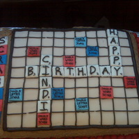 Scrabble Birthday Cake Chocolate/cinnamon 1/2 sheet cake filled with chocolate icing. Frosted with chocolate powered sugar icing and game board made of ivory...