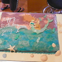 Mermaid Birthday Cake Full sheet chocolate mud cake filled with blackberry buttercream. Decorated with three different blue/green colors marbled together and...