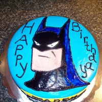 Batman Cake Little boy turning 4 loves Batman....Banana Cake (with yellow and black inside) with BC icing in middle, covered in MMF. The Batman is...
