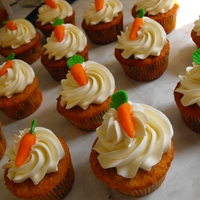 Carrot Cupcakes carrot cake with orange blossom swiss meringue buttercream and white chocolate carrot decorations