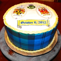 Tartan Grooms Cake tartan print icing on white chocolate swiss meringue on Madagascar vanilla cake and chocolate hazelnut filling. Sugar paste hand painted...