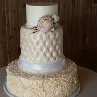 Lots Of Textures Smooth buttercream fondant quilted double decker tier and ruffle flower texture buttercream bottom tier