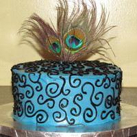 Peacock Inspired Cake 1st attempt at scroll work, buttercream icing with black piping