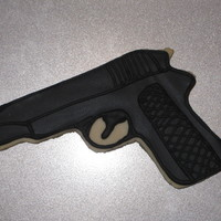 Gun Cookies My 13-yr-old daughter made these for a birthday party. I printed out a picture of a gun, traced it onto card stock and then cut it out. She...