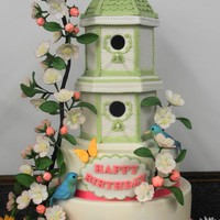 Spring Bird House Cake Birdhouse is gingerbread covered in fondant so it could be kept as a keepsake. The apple blossoms are fondant with tylose added. Bluebiirds...