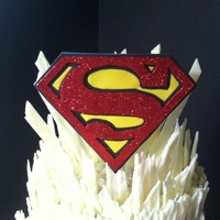 Superman Fortress Of Solitude Carrot Cake with Cream Cheese White Chocolate FortressSuperman Logo is fondant/ gum paste with red disco dust