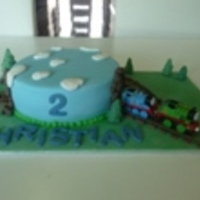 Thomas Tank Engine  The Thomas's were supplied by customer. Everything else was made by fondant, the rocks, tracks and trees. It is more fiddly than I...