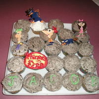 Phineas And Ferb Cupcakes cookies and cream cupcakes, with characters piped out of chocolate.