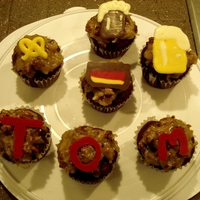 German Chocolate Cupcakes: Oktoberfest! These are German chocolate cupcakes covered with the traditional coconut pecan frosting. I added symbols of Germany: glasses of beer,...