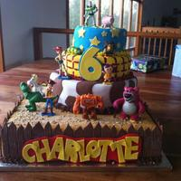 Toy Story Birthday Cake Made for my cousin. Top cake is vanilla and Rasberry, middle is vanilla, jam and cream, bottom cake is chocolate and choc cream. The bootom...