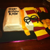 Harry Potter Book Cake Open book cake....one side vanilla and rasberry, the other chocolate and chocolate fudge filling. Scarf, glasses, coins and wand all...