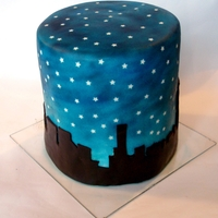 "Skyline Cake This is a double high 8"" round cake covered in ganache and fondant. I covered the cake with paper stars, airbrushed it, then removed..."
