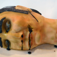 Severed Head Cake This is the severed head cake I made for my friends birthday/Halloween party. It is a chocolate cake, chocolate buttercream, white...