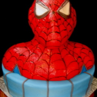 Spidey Senses Say Someone's Having A Birthday The blue portion is vanilla cake with vanilla buttercream filling covered in fondant. Spidey is a rice cereal sculpture covered with...