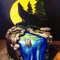 Have A Howling Good Time On Your Birthday A dark chocolate cake filled and crumbcoated in Nutella buttercream and covered in marshmallow fondant. The moon and sillhouettes are gum...