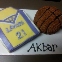 Lakers Jersey & Basketball Cake I did this cake as a surprise for my nephew's 14th birthday...he loves basketball and the Lakers are his favorite team and 21 is his...