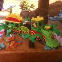 Ride... The Dinosaur Train! Devils Food Cake with buttercream icing, the train and mountain are Rice Krispy Treats covered in fondant. Buddy and Tiny as well as all...