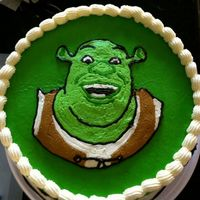 Shrek MY first attempt at FBCT. All buttercream with fondant letters.