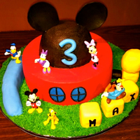 Mickey Mouse Clubhouse Inspired by the many Mickey cakes on CC. All buttercream with fondant accents. Characters were bought from the disney store. TFL!