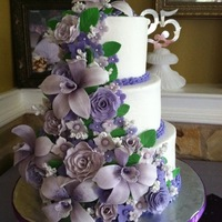 Orchid And Rose Cascade All gum paste flowers on buttercream cake.