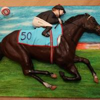 Racehorse Cake Racehorse cake for a friend's 50th birthday. It's freshly painted so it hadn't quite dried. It was a chocolate cake with...