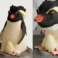 Rockhopper Penguin Baby Shower Cake. Rockhopper penguin. 14 inches tall carved from chocolate cake. Covered in modelling chocolate. The egg was a pink angel cake inside to...