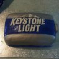 Keystone Light B-Day Cake Made this cake for my cousins 19th b-day. Was banana cake with vanilla butter cream frosting, Used the box of 15 cans for the lettering and...